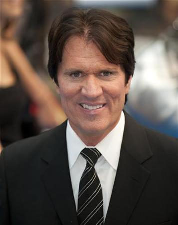 U.S. director Rob Marshall poses for photographers as he arrives for the premiere of his new film ''Pirates of the Caribbean: On Stranger Tides'' at the Westfield Cinema in London May 12, 2011. REUTERS/Kieran Doherty