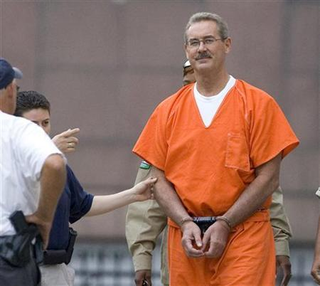 Texas billionaire Allen Stanford arrives at the Federal courthouse in Houston, in the custody of U.S. marshalls, June 25, 2009. REUTERS/ Steve Campbell