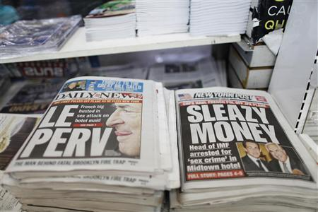 Stories regarding the arrest of Dominique Strauss-Kahn, the head of the International Monetary Fund (IMF), are seen on the front pages of the New York Daily News and the New York Post in New York May 15, 2011. REUTERS/Lucas Jackson