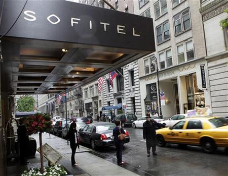 People pass by the Sofitel hotel after IMF chief Dominique Strauss-Kahn was arrested and charged on Sunday with sexually assaulting a New York hotel maid, May 15, 2011. The hotel maid, 32, alleged Strauss-Kahn sexually assaulted her in his $3,000-a-night suite at the upscale Sofitel in Times Square on Saturday, police spokesman Paul Browne said. REUTERS/Chip East
