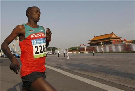 Samuel Kamau Wansiru of Kenya runs in front of the Tiananmen Gate after the start of the men's marathon at the Beijing 2008 Olympic Games, August 24, 2008. REUTERS/Reinhard Krause