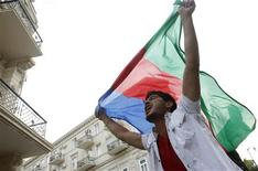 <p>A man celebrates with the country's national flag after Ell-Nikki of Azerbaijan won the Eurovision song contest, on a street in central Baku May 15, 2011. REUTERS/David Mdzinarishvili</p>