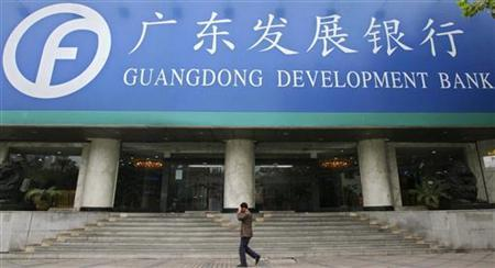 A man walks past a branch of Guangdong Development Bank (GDB) in Nanjing, east China's Jiangsu province, November 17, 2006. REUTERS/Sean Yong