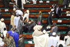 <p>Members of the Nigerian House of Representatives argue during a legislative session at the parliament chamber in Abuja, June 22, 2010. REUTERS/Stringer</p>