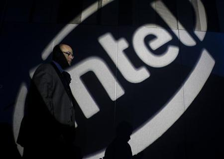 A man walks past an Intel logo during a news conference by Intel Chief Executive Paul Otellini in Taipei in this October 28, 2010 file photo. REUTERS/Nicky Loh