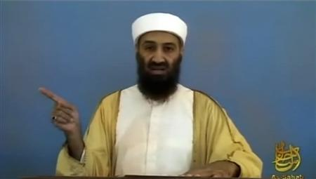 Osama bin Laden is shown pointing in this file video frame grab released by the U.S. Pentagon May 7, 2011. REUTERS/Pentagon/Handout/Files
