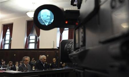 IMF chief Dominique Strauss-Kahn is seen in the viewfinder of a television camera as he is arraigned in Manhattan Criminal Court in New York, May 16, 2011. REUTERS/Andrew Gombert/Pool