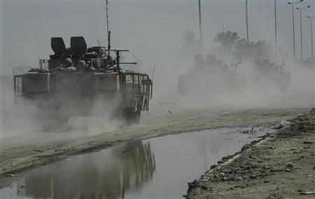 A convoy of British armoured personnel carriers patrol a road in Basra, 550 km (340 miles) south of Baghdad in this February 21, 2007 file photo. REUTERS/Wisam Ahmed