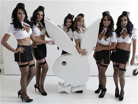 Six former air hostesses of Mexicana Airlines pose during a news conference before taking part in a private session for Playboy magazine in Mexico City February 7, 2011. REUTERS/Henry Romero