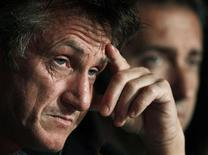 "<p>Cast member Sean Penn (L) attends a news conference with director Paolo Sorrentino (R) for the film ""This Must Be The Place"", in competition at the 64th Cannes Film Festival, May 20, 2011. REUTERS/Eric Gaillard</p>"