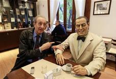 "<p>Lorenzo Pepe, director of the Juan Peron institute, gestures as he sits next to a statue of former Argentine President Juan Peron at the ""Un cafe con Peron"" (A coffee with Peron) restaurant in Buenos Aires May 8, 2011. REUTERS/Marcos Brindicci</p>"