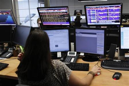 A trader looks at screens at a bank in Lisbon May 18, 2011. REUTERS/Hugo Correia