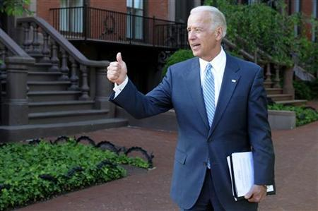 Vice President Joe Biden gives a thumbs-up as he departs after meeting with a bipartisan group of lawmakers to work on a legislative framework for comprehensive deficit reduction at the Blair House in Washington May 10, 2011. REUTERS/Jonathan Ernst
