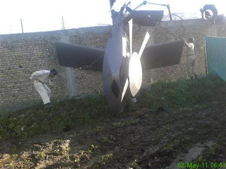 Part of a damaged helicopter is seen lying near the compound after U.S. Navy SEAL commandos killed al Qaeda leader Osama bin Laden in Abbottabad, May 2, 2011. REUTERS/Stringer