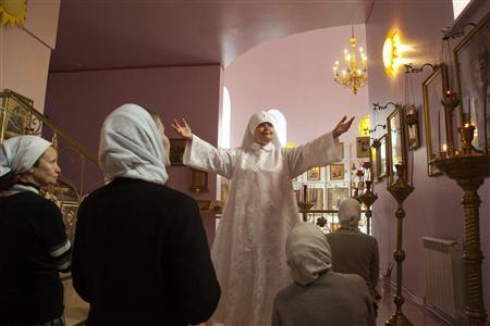 Svetlana Frolova leads a service at her sanctuary at Bolshaya Yelena, a village near central Russia's city of Nizhny Novgorod May 15, 2011. REUTERS/Natalia Plankina