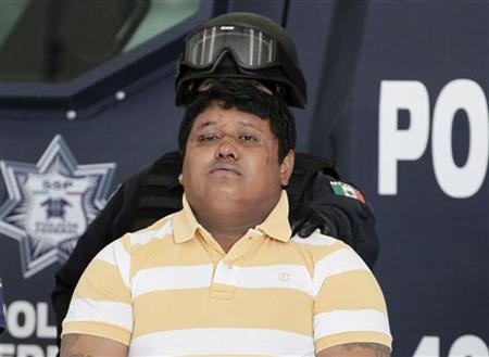 Suspect Julio de Jesus Radilla Hernandez ,34, alias '' El Negro'' is presented to the media by the Federal Police in Mexico City May 25, 2011. REUTERS/Henry Romero