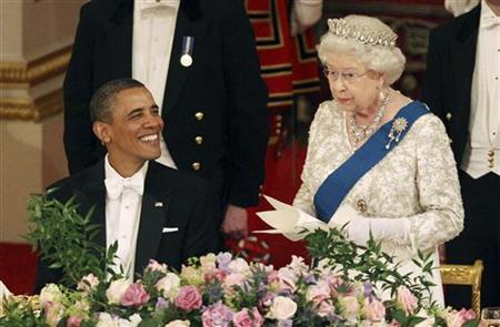 Britain's Queen Elizabeth speaks next to U.S. President Barack Obama during a State Banquet in Buckingham Palace in London May 24, 2011. REUTERS/Lewis Whyld/PA Wire/Pool