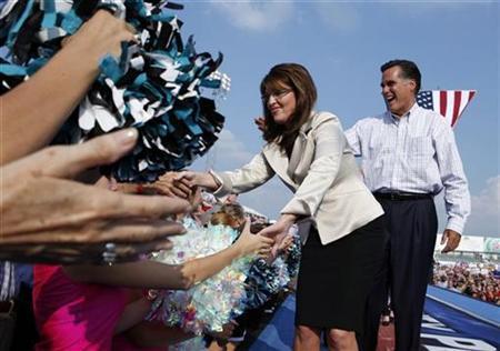 Sarah Palin and Mitt Romney in O'Fallon Missouri in 2008. REUTERS/John Gress