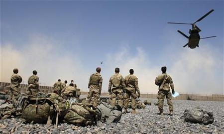 Helicopters carrying U.S. Army soldiers from the 1-320 Field Artillery Regiment, 101st Airborne Division, take off from Combat Outpost Terra Nova as the soldiers head home following a 10-month deployment in the Arghandab Valley north of Kandahar April 23, 2011. REUTERS/Bob Strong