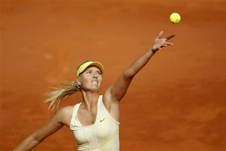 Maria Sharapova of Russia serves to Caroline Garcia of France during the French Open tennis tournament at the Roland Garros stadium in Paris May 26, 2011. REUTERS/Charles Platiau