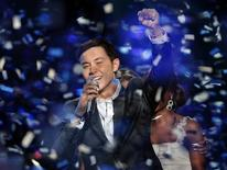 """<p>Scotty McCreery celebrates after winning the 10th season of """"American Idol"""" during the show's finale at the Nokia Theatre in Los Angeles, California May 25, 2011. REUTERS/Michael Becker/Fox/Handout</p>"""