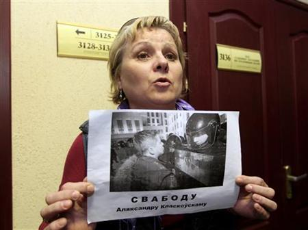 Ludmila Klaskovskaia, mother of Alexander Klaskovski who was sentenced to jail, holds his photo in a court building in Minsk May 26, 2011. REUTERS/Vasily Fedosenko