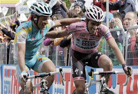 Astana rider Paolo Tiralongo (L) of Italy embraces Saxo Bank rider Alberto Contador of Spain after winning the 209km (130 miles) 19th stage of the Giro d'Italia cycling race from Bergamo to Macugnaga May 27, 2011. REUTERS/Alessandro Garofalo