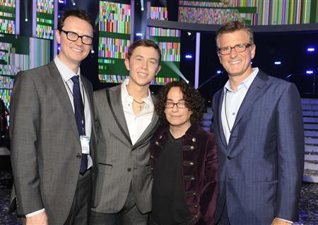 Peter Rice, chairman of Entertainment Fox Networks Group, Season 10 ''American Idol'' winner Scotty McCreery, Mike Darnell, president of Alternative Programming Fox Broadcasting and Kevin Reilly, president of Entertainment, Fox Broadcasting Co. (L-R) pose after the Season 10 ''American Idol'' Grand Finale at the Nokia Theatre in Los Angeles, California May 25, 2011. REUTERS/Michael Becker/Fox/Handout