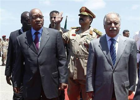 Libya's Prime Minister Al-Baghdadi Ali Al-Mahmoudi (front R) walks with South Africa's President Jacob Zuma (front L) upon his arrival at Mitiga airport in Tripoli May 30, 2011. REUTERS/Ismail Zetouny