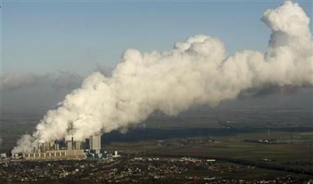 An aerial view shows steam billowing from the cooling towers of a coal power plant in the western town of Neurath December 4, 2009. REUTERS/Ina Fassbender