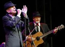 <p>Canadian singer-songwriter Leonard Cohen (L) performs at the Coachella Music Festival in Indio, California April 17, 2009. REUTERS/Mario Anzuoni</p>