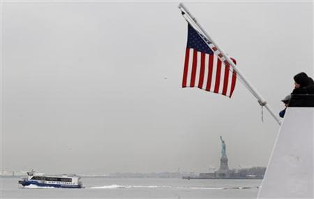 A ferry boat carrying tourists departs the dock for Liberty Island, to see the Statue of Liberty, and Ellis Island in New York, April 8, 2011.