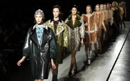 Models parade at the end of Prada Autumn/Winter 2011 women collection show at Milan's Fashion Week February 24, 2011. REUTERS/Stefano Rellandini