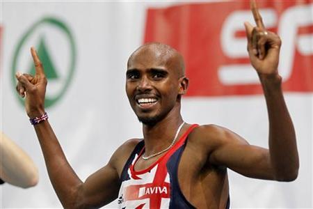 Mo Farah reacts after winning the 3000m men's final at the European Athletics indoor championships in Paris March 5, 2011. REUTERS/Charles Platiau