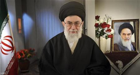 Iran's Supreme Leader Ayatollah Ali Khamenei sits next to a portrait of late leader Ayatollah Ruhollah Khomeini while taking part in a live television programme in Tehran on the occasion of the Iranian New Year March 21, 2011. REUTERS/Leader.ir/Handout