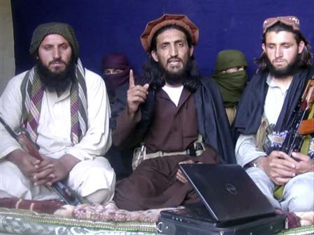 In this image taken from a video recording, Omar Khalid Khorasani (C), a top Pakistan Taliban commander, gives an interview in Pakistan's Mohmand tribal region on June 2, 2011. REUTERS/Handout