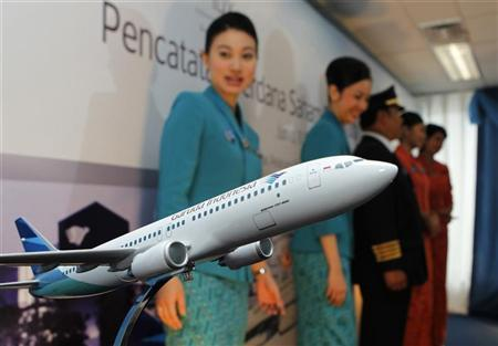 Crew members of Indonesia's Garuda airline attend the airline's initial public listing in Jakarta February 11, 2011. REUTERS/Enny Nuraheni