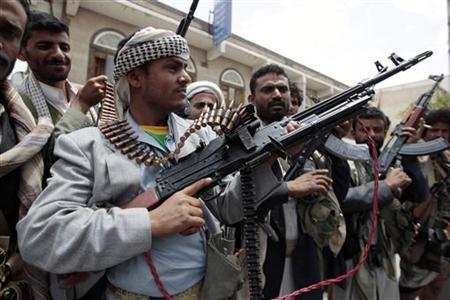 Tribesmen loyal to Yemeni tribal leader Sadeq al-Ahmar secure a street near al-Ahmar's house in Sanaa June 7, 2011. REUTERS/Ammar Awad