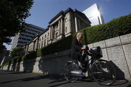 A man on a bicycle rides past the Bank of Japan headquarters in Tokyo May 19, 2011. REUTERS/Yuriko Nakao