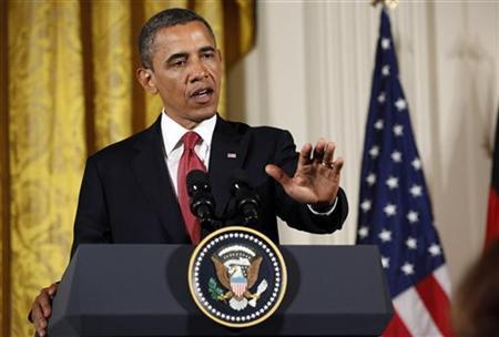 U.S. President Barack Obama gestures during a joint press availability with German Chancellor Angela Merkel (not pictured) in the White House in Washington June 7, 2011. REUTERS/Jim Young