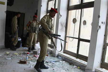 Military police secure the Ministry of Trade and Industry building after recent clashes between police and tribesmen loyal to the tribal leader Sadiq al-Ahmar in Sanaa, June 8, 2011. REUTERS/Khaled Abdullah