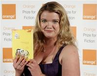 <p>Tea Obreht poses with her novel The Tiger's Wife at the Royal Festival Hall in London June 8, 2011. REUTERS/Chris Helgren</p>