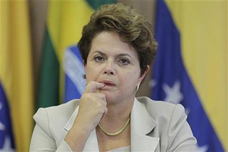 Brazil's President Dilma Rousseff gestures during a news conference after a meeting with Venezuela's President Hugo Chavez at Planalto Palace in Brasilia June 6, 2011. REUTERS/Ueslei Marcelino