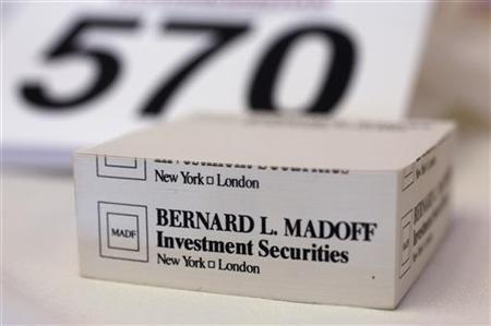 A ''stickies'' pad embossed with the investment firm of convicted Ponzi schemer Bernard Madoff is seen among the articles in Lot 570 of stationary that was won by Mike Burd of Long Island at an auction by the U.S. Marshalls Service at the Miami Beach Convention Center in Miami Beach, Florida June 4, 2011. REUTERS/Hans Deryk