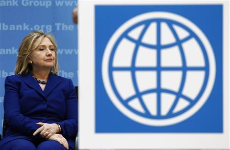 Secretary of State Hillary Clinton listens to remarks during a ceremony at World Bank Headquarters in Washington in this March 22, 2011 file photo. REUTERS/Jim Young/Files