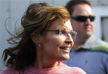 Former Alaska governor Sarah Palin looks back at a reporter during her visit to Yankee Seafood Cooperative in Seabrook, New Hampshire, June 2, 2011. REUTERS/Brian Snyder
