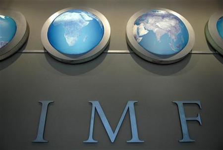 The IMF nameplate is displayed on a wall at the headquarters during the World Bank/International Monetary Fund Spring Meetings in Washington April 11, 2008. REUTERS/Jonathan Ernst