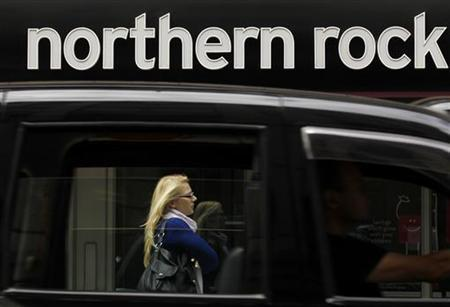 A black cab drives past a branch of Northern Rock in the City of London, August 3, 2010. REUTERS/Andrew Winning