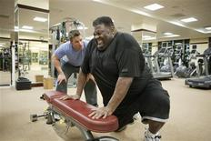 "<p>Trainer Chris Powell (L) coaches Dana Baker on U.S. reality TV show ""Extreme Makeover: Weight Loss Edition"" in this undated 2011 handout. REUTERS/ABC/Greg Zabilsky</p>"