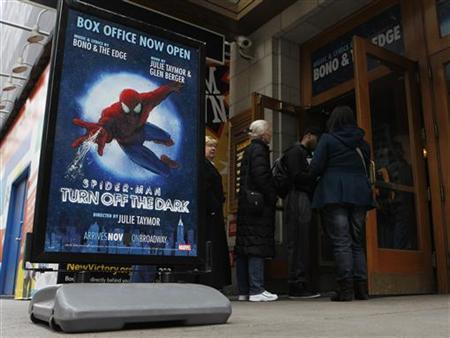 Patrons wait in line at the box office of the Foxwoods Theater, home to the Broadway play ''Spiderman: Turn Off The Dark'' in New York March 9, 2011. The $65 million ''Spider-Man: Turn Off the Dark'' REUTERS/Brendan McDermid